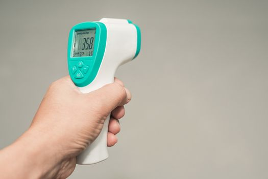 Hand held thermometer to measure fever and free space
