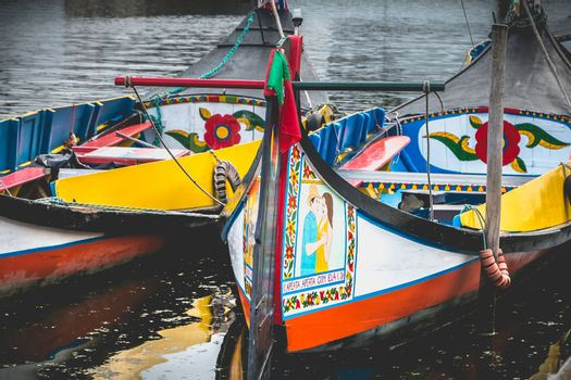 Aveiro, Portugal - May 7, 2018: view at the dock of the famous Moliceiros, traditional boats that used to harvest algae once and now transport tourists to the city canals