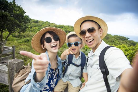 happy asian Family On Hiking Adventure and taking selfie