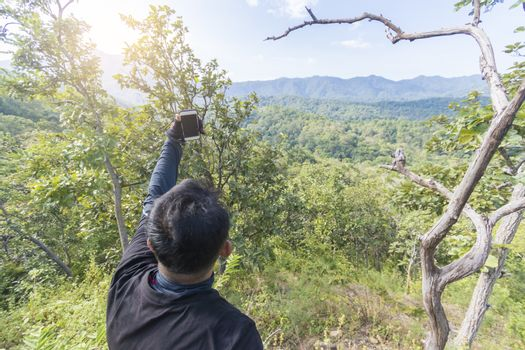 Man taking selfie on top of the mountain,Thailand