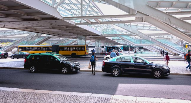 Lisbon, Portugal - May 7, 2018: Taxis cars parked in front of Oriente Intermodal Station Lisbon, a railway and road station completed in 1998 for Expo 98