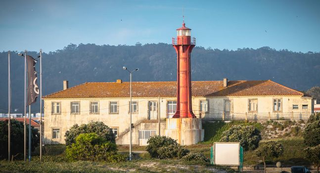 Esposende, Portugal - May 8, 2018: Architectural detail of the Esposende lighthouse near Sao Joao Baptista Fort by the sea on a spring day