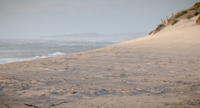 idyllic beach of fine sand in Portugal in the evening