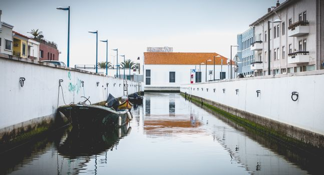 Aveiro, Portugal - May 7, 2018: Small boat docked on a canal in the city on a spring day