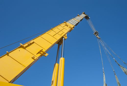 Large crane jib against blue sky background