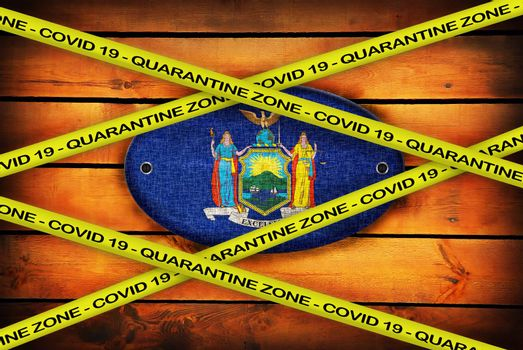 COVID-19 warning yellow ribbon written with: Quarantine zone Cover 19 on New York flag illustration. Coronavirus danger area, quarantined country.