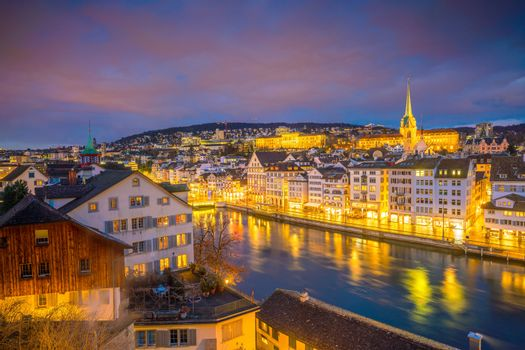 Cityscape of downtown Zurich in Switzerland during dramatic sunset.