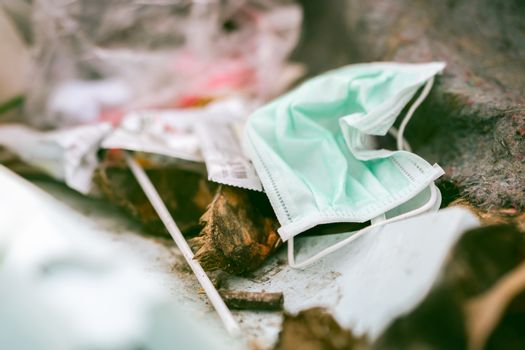 Used face mask discard in household garbage. Medical waste dispo