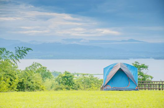 Camping trip tent on holiday. Adventures Camping tourism and tent.  Beautiful lake with tent in place for camping at Srinakarin Dam viewpoint in Huai Mae Khamin Waterfall ,Thailand.
