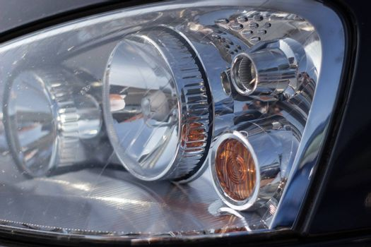 Right front headlight of the car.