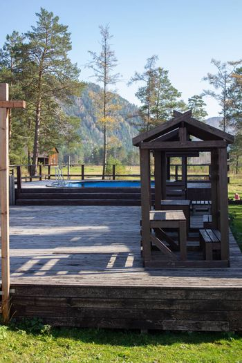 Wooden gazebo and outdoor swimming pool near the hotel.