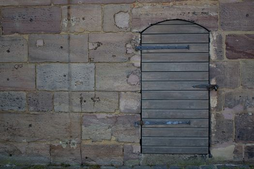 Wooden door in an old wall