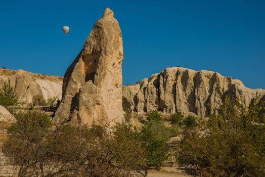 Goreme region, Cappadocia, Anatolia, Turkey: Flying in a balloon. Mountain view in summer in Sunny weather. The great tourist attraction of Cappadocia - balloon flight.