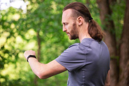 Sport man looking at smart watch