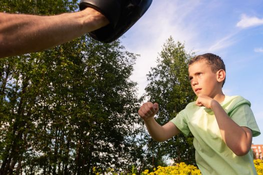 Father and son training to box