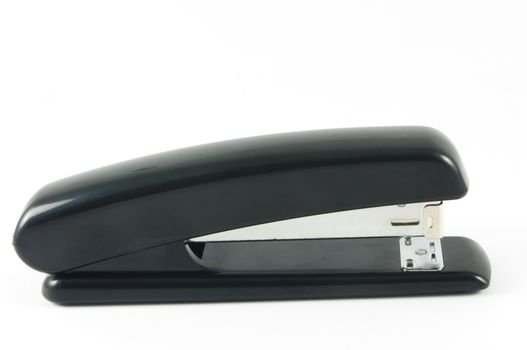 Black stapler on white surface
