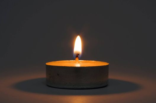 Close up of memorial candle in the darkness