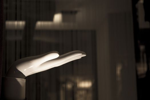 White mannequin hand. Palm down. No people