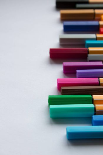 Many different colored pens. Color pencils isolated on a white background.