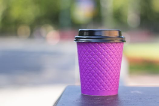 purple paper coffee Cup on the stove.