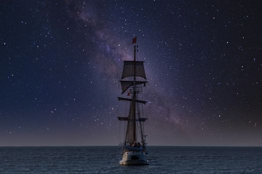 Antique tall ship, vessel leaving the harbor of The Hague, Scheveningen under a clear milky way sky