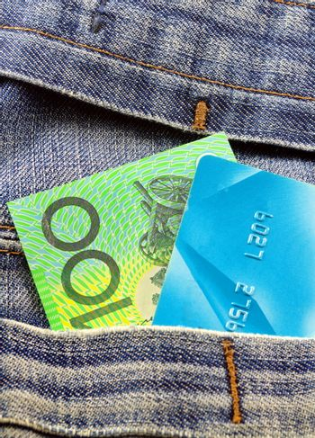 australian money and credit card in jeans pocket
