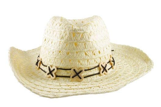 Closeup of white yellow large hat over white surface