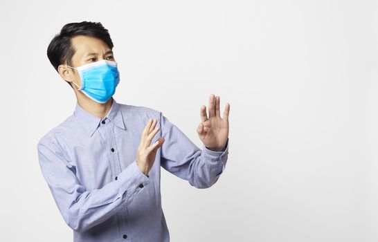 Asia man panic disorder wearing surgical mask covering mouth and nose. epidemic corona virus protection.