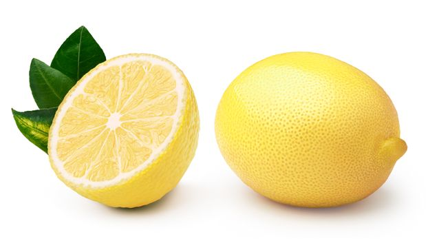Whole and halved lemon with leaves, separated. Clipping paths, infinite depth of field