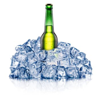 Green beer bottle, cooling down in a rough crushed ice. Clipping paths
