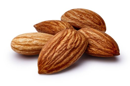 Heap of shelled almonds (fruits of Prunus amygdalus). Infinite depth of field,clipping paths