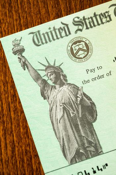 United States Internal Revenue Service, IRS, Check On Desk.