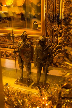 Tallinn, Estonia: Beautiful dStatues of gold medieval knights in the souvenir shop. Popular tourist destination in Estonia's capital.