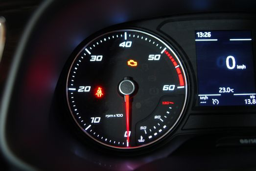 ar Tachometer photographed in a car that stands