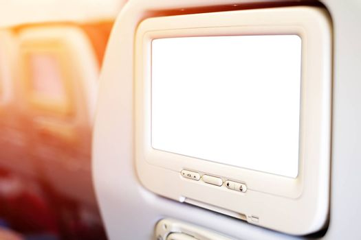 Aircraft monitor in passenger seat isolated on white background with clipping path