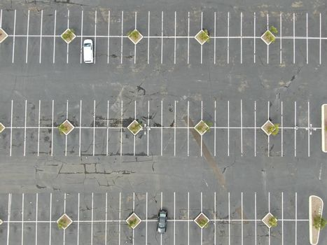 Aerial view of empty shopping center parking lot during COVID-19 pandemic.. Coronavirus virus and panic buying concept