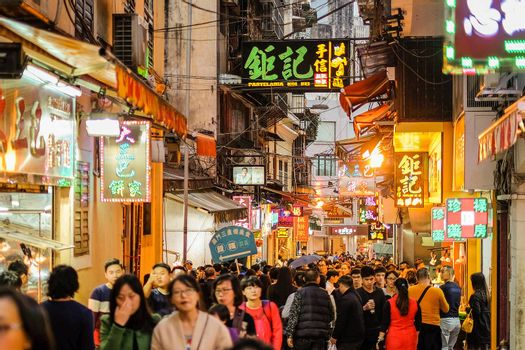 MACAU,CHINA January 11: Crowd people for tourism in Macau historic area of city in 11 January 2016