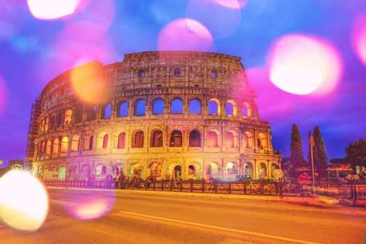 Colosseum, Rome, Italy. Twilight view of Colosseo in Rome with boken effect