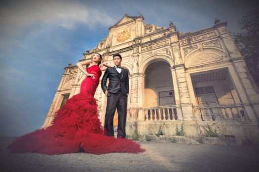 Man and Beautyful woman wearing fashionable red dress