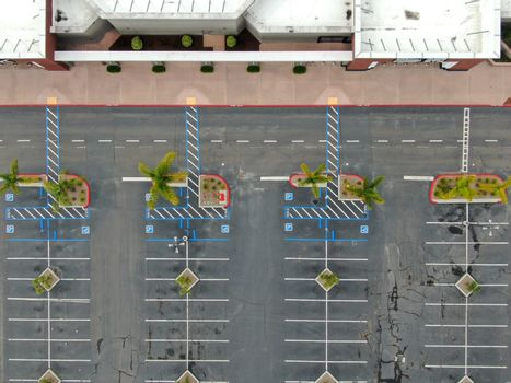 Aerial view of empty shopping center parking lot during COVID-19 pandemic.. Coronavirus virus and panic buying concept. San Diego, USA, March 22nd, 2020
