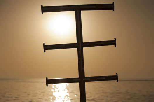 Silhouette of a ladder in the sunset
