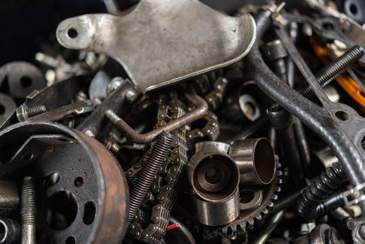 Disassembled car engine old vehicle part at garage