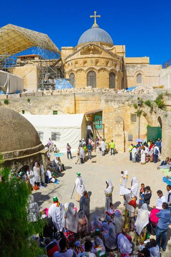 JERUSALEM, ISRAEL - APRIL 29, 2016: A crowd of Ethiopian Pilgrims gather in the Deir Es-Sultan, part of the church of the Holy Sepulcher, in Orthodox Good Friday. The old city of Jerusalem, Israel