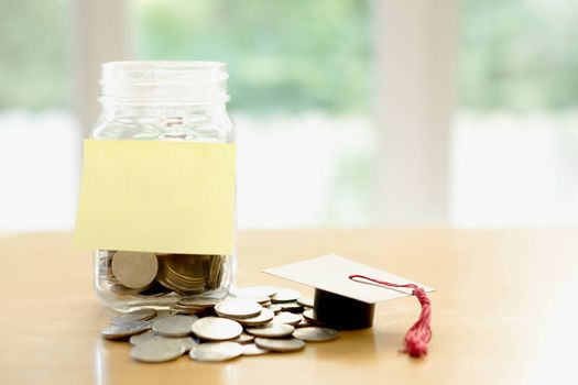Education budget concept. education money savings in a glass