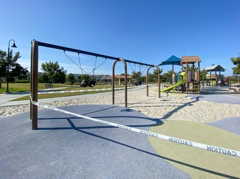 Closed community park with playground for kids due to Covid 19. Coronavirus virus panic and quarantine in San Diego, California, USA.