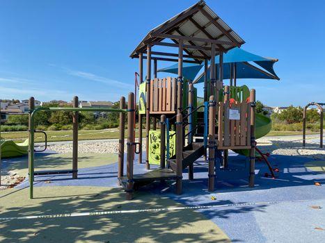 Closed community park with playground for kids due to Covid 19. Coronavirus virus panic and quarantine in San Diego, California, USA.