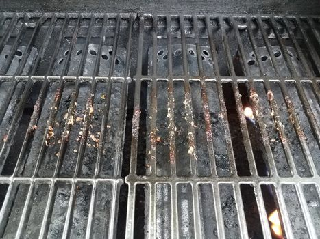 dirty or filthy bars on barbecue grill
