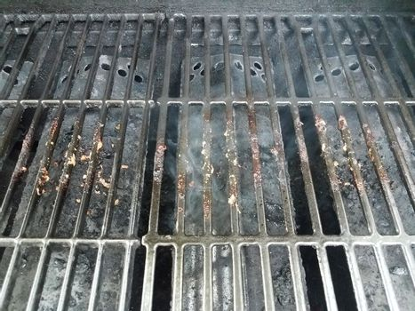 dirty or filthy bars on barbecue grill wih smoke