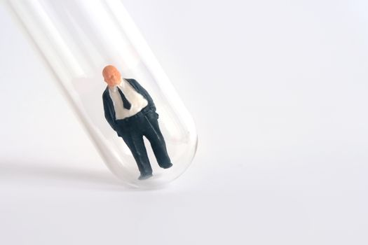 Health conceptual miniature people photography – testing specimen, a businessman on a laboratory test tube. Image Photo