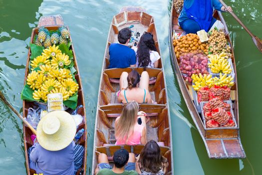 Tourists visiting by boat at Damnoen Saduak floating market in R